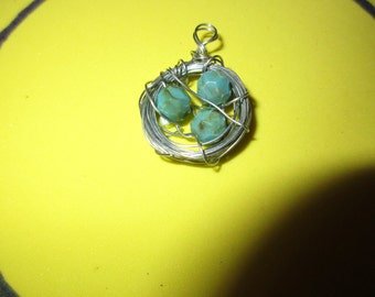Silver wire wrapped around three blue beads, pendant