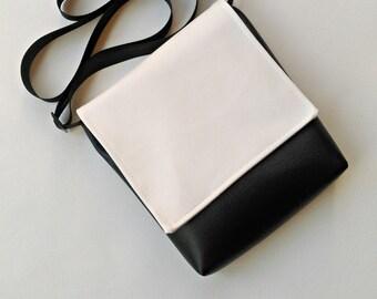 Timeless white  and black messenger vegan faux leather vinyl bag handbag