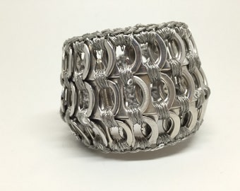 Band bracelet made with pop tabs from cans tabs