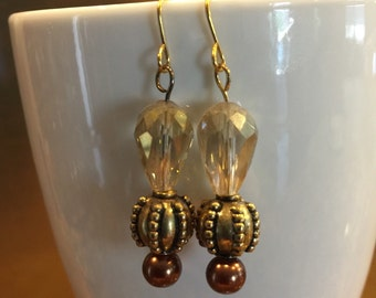 Faceted beige glass dangle earrings