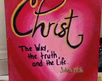 Christian scripture on painted canvas