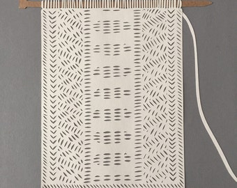 Knitted scarf papercut