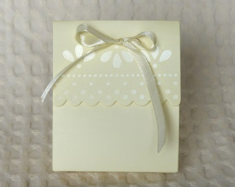 Cream, ivory ribboned wedding favor boxes - perfect for weddings, parties, or gifts.  For holding wedding favors, candy, or confetti.