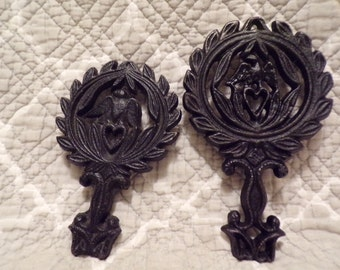 "Set of 2 Small Trivets - 1 marked ""Wilton"" 1 marked 9-23 Eagle"