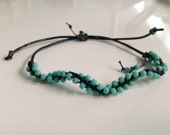 Turquoise colored beaded slip knot bracelet