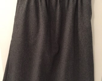 Grey wool skirt with pockets