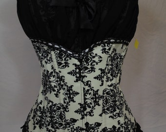 White with black print brocade Corset with Black sheer overlay.