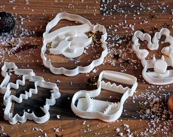 Christmas (Xmas) Cookie Cutters x 4 - Santa, Xmas Tree, Rudolf, Xmas Stocking