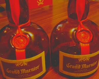 Grand Marnier bottles; empty.