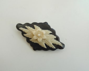 Brooch: Black and ivory coloured
