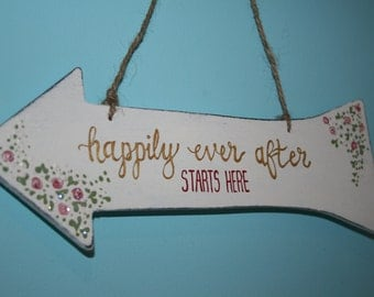 Happily ever after starts here' wedding arrow sign