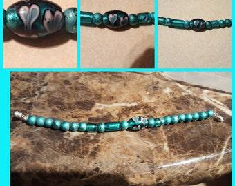 Aqua blue hand painted beads bracelet