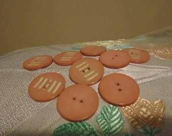 coral pink bakelite buttons x 9