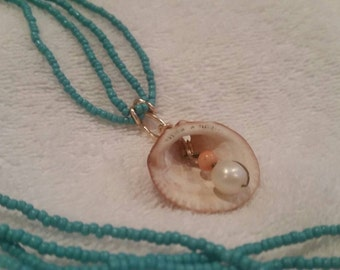 Beautiful fresh water pearl / coral on blue beaded over neck