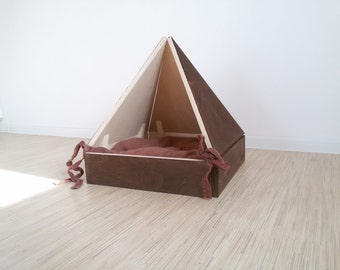Wooden house for a cat or a little dog. Pet cave and bed.