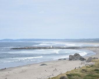Lighthouse: Landscape photograph of waves crashing against the shore in Bandon, Oregon