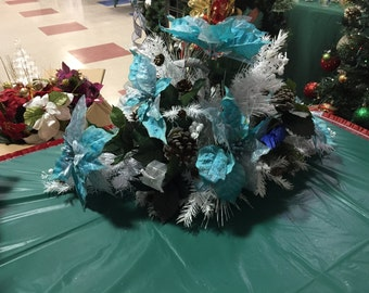 Blue poinsettia and white evergreen centerpiece for Christmas