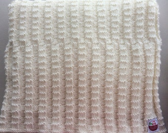 Cream hand knitted cot blanket/throw
