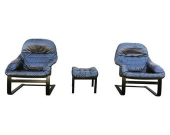 Mid Century Leather Chairs, Is Made in Denmark.