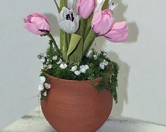Pink tulips in a miniature clay pot