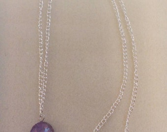 Silver chain with pendant.
