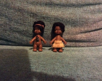 Small black dolls/ figurines