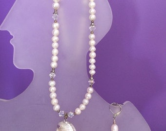 Freshwater pearls with the shell pendant