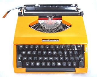Sperry Remington, Sperry Remington 10/50, 1970's, yellow typewriter, working typewriter, portable typewriter.