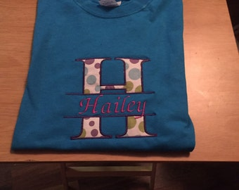 Shirt applique first initial and name going through it