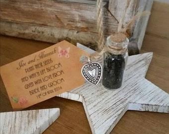 Seed favour wedding favors in mini glass bottle personalised with a tag and filled with wild flower seeds