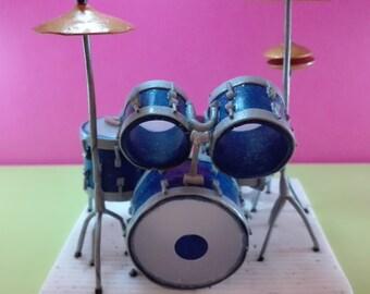 Realistic miniatures, musical instrument: drums, percussion, diorama. Glitter blu