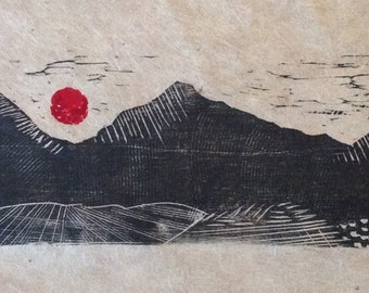 original limited edition woodcut print of mountains and red sun