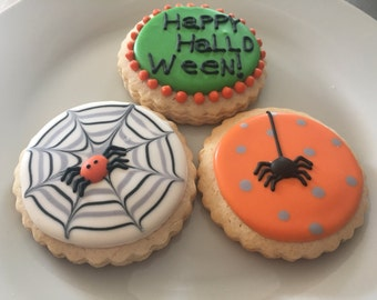 Halloween theme spider web sugar cookies, Halloween cookie favors, treat or trick cookies.  Order includes one dozen (12) cookies.
