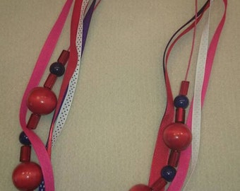 Blue and red beads and ribbon necklace