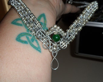 Silver woven circlet with green beads