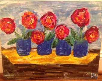 4 Flowers Vases in a Row