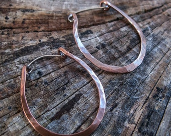 Simple copper and sterling silver hoops