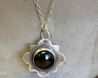 Quatrefoil Pendant in Sterling Silver with Black Onyx Stone