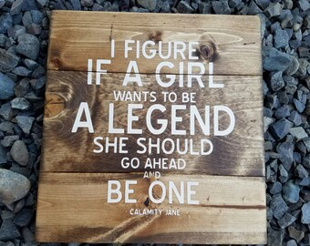If a girl wants to be a legend stained wood sign