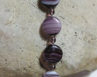 Vintage glass, striated plum glass bracelet