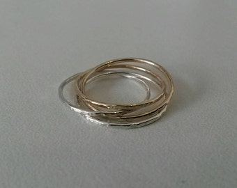 Silver and gold fine and modern hammered ring with 4 interlace rings.