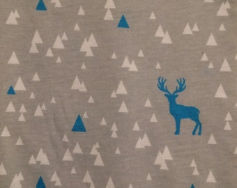 Grey baby leggings with white and blue triangles and deer