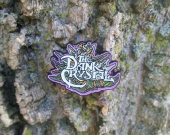 The dank crystal glow in the dark pin