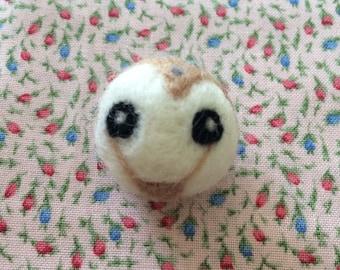 Tiny little needlefelt barn owl brooch.