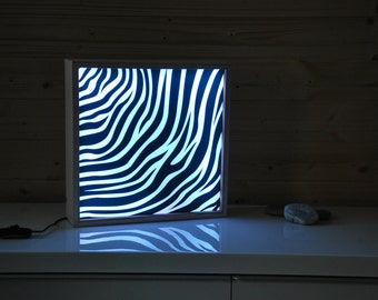 LED light box with interchangeable plexi to customize with text or photos of your choice