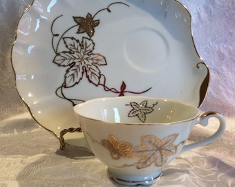 Vintage mid century Japan lunch plate and tea cup Nippon bone china shell shape