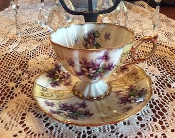 Vintage Japan footed Bone china cup saucer blue violets floral pattern