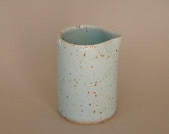 Spotty blue stoneware pourer