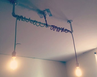 Fabric wired pipe light