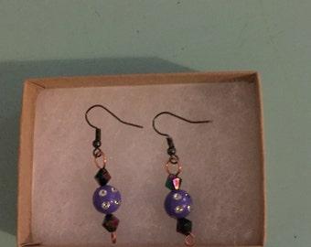 Drop earrings with purple ball